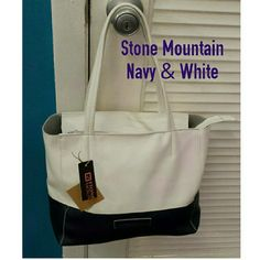 "Stone mountain navy blue & white handbag NWT Lovely navy blue and crisp white handbag. 14"" long x 10"" tall x 5"" wide. 9"" double drop handles. Zipper top  Inside zipper wallet pocket and big inside pockrt for cellphone, etc. Small embossed White Mountain name and logo on the front. Lightweight faux leather. Gorgeous bag perfect for all seasons. Brand new with tag. No flaws, stains or tears. Never used. Bags Shoulder Bags"