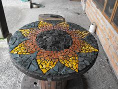 Mosaic table made on an old cable drum