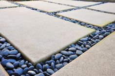 Mexican Beach Pebbles from Empire Stone for between the concrete square pavers. Pebble Landscaping, Modern Landscaping, Landscaping Ideas, Mexican Beach Pebbles, Sand And Gravel, Paving Ideas, Path Ideas, Paving Stones, Stepping Stones