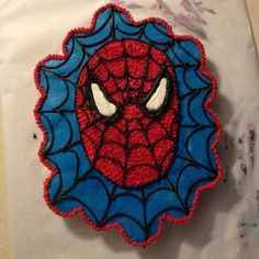 My first Spiderman cupcake-cake! Don't mind all the messy icing around it:)