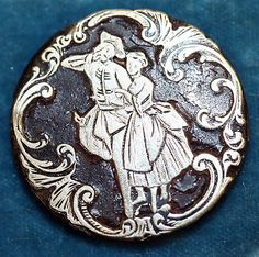 Button one of a set of 10, ca.1780, French, horn and silver.