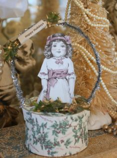 Doll atop a Holly Box to hold sm gift