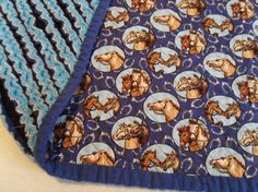 Handmade frayed flannel baby Quilt featuring layers of different blues topped with Kentucky race horses by StarBoundHorses
