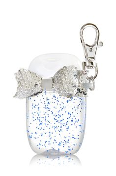 Bath & Body Works Silver Bow PocketBac Holder | All dolled up! Shiny sequins on a beautiful bow add the perfect finishing touch to your favorite PocketBac. The convenient clip attaches to your backpack, purse and more so you can always keep your favorite sanitizer close at hand.