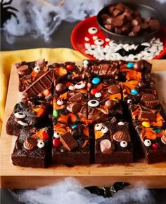Looking for perfect fudgy Halloween brownies recipes to share with family and friends? These delicious brownies are stuffed full of gooey Trick or Treat candy and a spooky cream cheese swirl all on top of a super chocolaty brownie. These decadent brownies are made for sharing! Completely fun to bring to Halloween parties. Little monsters love these fudgy treats! A great way to use up and share Halloween candy that may be leftover from the holiday!