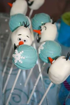 Olaf and snowflake cake pops at a Frozen birthday party!  See more party planning ideas at CatchMyParty.com!