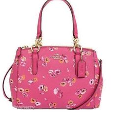 "Authentic Coach Christie Satchel Wildflower NWT Authentic Coach Crossgrain Leather Mini Christie Satchel in Pink Wildflower. 3 Seperate Compartment 2 Side Zip Close with 1 inside zipper pocket, middle compartment snap closure with 2 inside slip pockets.  Dahlia Pink Crossgrain Leather w/ Multicolored Wildflower Print Cinched Sides Gold-Tone Hardware Flat Bottom Embossed Metal Coach Medallion on Front Leather Coach Hangtag Dual Flat Handles w/ 6"" Drop Removable, Adjustable Strap w/ 24"" Drop…"