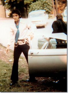 Elvis getting out of his car, man the guy looks great no matter what June 5, 1970.
