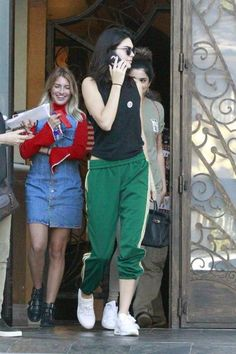 Kendall Jenner wearing Nike Air Max Thea Running Sneakers, Hermes Birkin Bag and Re/Done Muscle Tee in Black