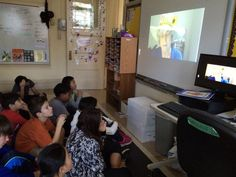 Susan Wallace's students are watching Ms. Jenaia read Chapter 6.
