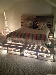 DIY pallet board bed frame and headboard idea. Used 10 pallet boards total for queen size mattress free from a restaurant (8 on bottom 2 as headboard). 3 packs of lights from ikea, $8 per pack strung through the pallets.