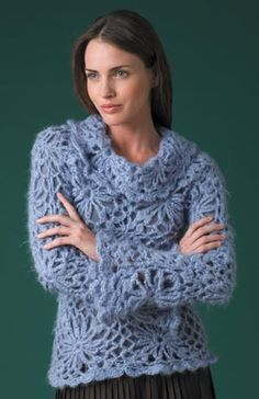 I just love crocheted sweaters!... adding the same scalloped edging around the bottom of a black skirt would make for an awesome outfit [especially love the loose neckline and bell sleeves of this sweater]... so pretty!