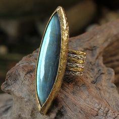 Labradorite Marquis ring with brass and sterling silver textured band. Jewellery designs by Sirilak Samanasak. http://sirilaksamanasak.com