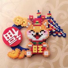 Happy Lunar New Year! Perler bead design by design Melty Bead Patterns, Hama Beads Patterns, Beading Patterns, Tile Patterns, Stitch Patterns, Sprites, Pixel Art, Bead Crafts, Arts And Crafts
