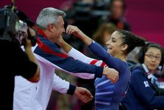 Alexandra Raisman of the U.S. is greeted by her coach, after she does her routine for the floor (: