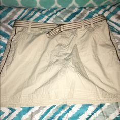 Sonoma Belted Khaki Skort Size 14 Looks new without tags!!  Khaki skirt by Sonoma.  Belt included.  Size 14.    Important:  I make sure all items are freshly laundered as applicable (shoes and tagged items, I don't remove the tags and wash).  However, not all my items come from pet/smoke free homes.  Low pricing reflective of this. Thank you for looking! Sonoma Shorts
