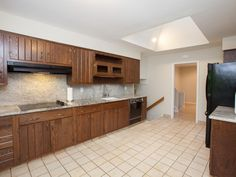While the kitchen may have been spacious, the dated cabinets and floor tile left much to be aesthetically desired.