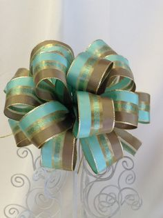 Check out this item in my Etsy shop https://www.etsy.com/listing/218372728/mint-green-and-gold-gift-bow-gift-bows
