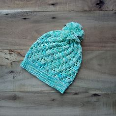 This pattern comes in 3 sizes, SM,L and it calls for fingering weight yarn. The width of the hat can be easily adjusted by adding the number of cast on stitches in multiple of 7 stitches.