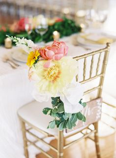The prettiest peony adorned sweetheart chair.