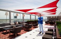 Q+A: Thom Filicia on Designing Delta's Outdoor Sky Deck Lounges, which feature Kevin Reilly's Klos Sconces