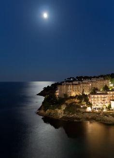 Moon shining over Cala Vina, Spain.