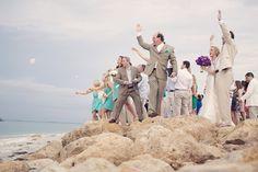 seashell toss ceremony at beach wedding, photo by reign7photo.com