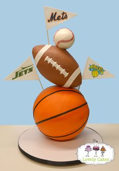 Sport balls cake - The bottom half of the basketball and also the bottom third of the football were Styrofoam for support.