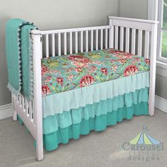 Crib bedding in Coral and Teal Floral, Solid Teal, Solid Seafoam Aqua, Solid Emerald Turquoise. Created using the Nursery Designer® by Carousel Designs where you mix and match from hundreds of fabrics to create your own unique baby bedding. #carouseldesigns