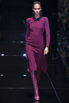 """FALL 2013 READY-TO-WEAR  Gucci /   For Spring, Frida Giannini went all in with color: azalea pink, fuchsia, and a Riviera blue that conjured sun-soaked images of the Italian jet set circa the seventies. Clearly, the Gucci designer prefers the dark side, because she's back in black for Fall, name-checking Allen Jones, the British Pop artist with the kinky streak, and juxtaposing, as her program notes put it, """"a demure, couture-inspired silhouette with a subversive undertone."""