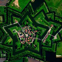"""Today we are doing a feed takeover for @theworldpost with a selection of Overviews from around the globe, including this one of Bourtange. This Dutch """"star fort"""" was built in 1593 during the Eighty Years' War when William I of Orange wanted to control the only road between Germany and the city of Groningen. Star forts were constructed in the manner you see here so that an attack on any of its five walls could be aggressively counteracted from the two adjacent star points."""