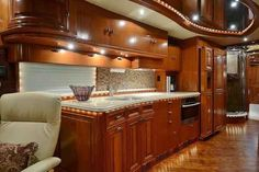 "2012 Used Liberty Coach Elegant Lady Class A in Florida FL.Recreational Vehicle, rv, Tuxedo Black, Champagne, Beige, and Golds are the colors of this timeless exterior. The Cherry wood veneer cabinetry with the solid raised panel doors is done to perfection as only Liberty Coach can do, complemented by the beige leathers and warm fabrics all resting on the worn wood floor make this a very rich and elegant living space that is timeless. The breakfast bar area has a 15"" computer monitor/TV for…"