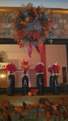 My mantel with repurposed wine bottles. I made the wreath too.