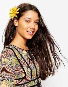Add a pretty flower to your hair to add some summer style! #asos #yellow #hair #accessories