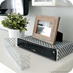 5 Design Tips and Tricks for Hiding Things You Don't Want to Look At boxes to hide cords 5 Design Tips and Tricks for Hiding Things You Don't Want to Look At Hide Cable Box, Hide Cables, Hide Tv Cords, New Living Room, Living Room Decor, Hide Router, Tv Over Fireplace, Ideas Prácticas, Easy Home Decor