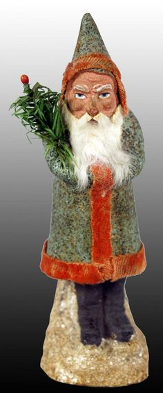 "Unusual Belsnickle Santa Candy Container. Gold flecked with mica flecked base. 6.5"", $ 1600"