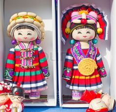 Image of Dolls in traditional chinese costumes