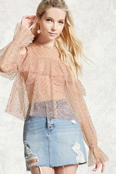 A sheer top featuring an allover metallic polka dot pattern, open-shoulder design, ruffled front and sleeves, long sleeves, and a back button closure with a keyhole cutout.