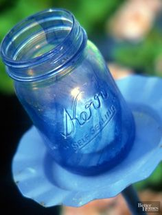 Cast a cool light on your deck or patio with these decorative votive holders. Pint-size canning jars, glazed with paint to match a garden's decorating scheme, provide pretty, low-cost candle lanterns. These blue-hue jars enhance the garden scene while protecting the votive candles from breezes.  /