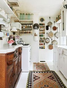 Cottage kitchen features antique buffet instead of standard cabinets along one wall...