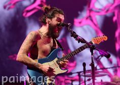 Simon Neil of Biffy Clyro performing on the Main Stage at the T in the Park festival, held at Balado Park in Kinross, Scotland.