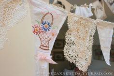 http://suzanneduda.typepad.com/my_weblog/2013/02/vintage-fabric-bunting.html?pintix=1