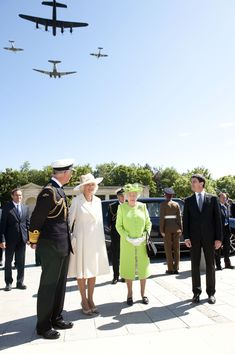 Prince Charles, Prince of Wales, Camilla, Duchess of Cornwall and Queen Elizabeth ll attend a service at Bayeux Cemetary during D-Day 70 Commemorations on June 6, 2014