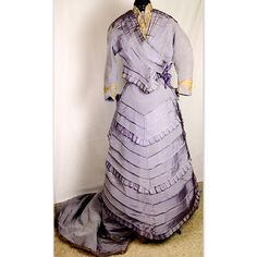 Lilac Silk Bustle Gown, trimmed with lace, c1875