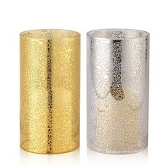 """Shine and dine. These glittery candle sleeves make the ultimate table accessories for your holiday party.FEATURES• 4.25"""" diameter x 8"""" height• Goldtone and silvertone MATERIALS• GlassCAREWipe clean."""