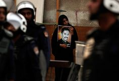 Manama, Bahrain: An anti-government protester holds a picture of jailed activist Abdulhadi al-Khawaja during a demonstration outside the British Embassy Photograph: Hasan Jamali/A