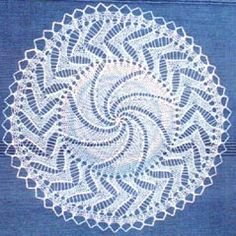 This site has many free vintage patterns for knitted lace doilies.