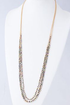 3 Iridescent Rella Necklaces - 3 separate Necklaces delicately suspended in layers, Golden nuggets are beautifully accented with Iridescent Seed Beads in Blue, Green and  Amethyst. Wear one or all. - just a photo idea.