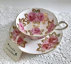 Beautiful vintage china tea cup, made by Royal Chelsea in England. This is a beautiful duet with a batwing handle, lots of gold gilding and a white ground with pink roses on both the cup and saucer. It is in good condition, no chips, cracks or crazing. Please Note: The items I sell are not new, they are vintage or antiques, it goes without saying that there maybe some imperfections which I will try my best to point out and take pictures of. I do not look at my items under a microscope, b...