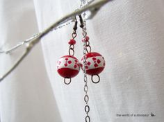 Handmade, hand painted earrings with folklore inspired patterns. See more here: https://www.facebook.com/theworldofadinosaur